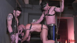 Cock hungry submissive guy gets both holes worked by two leather studs