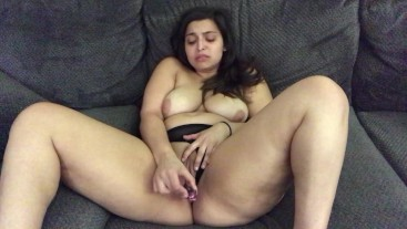 fucks herself with glass dildo
