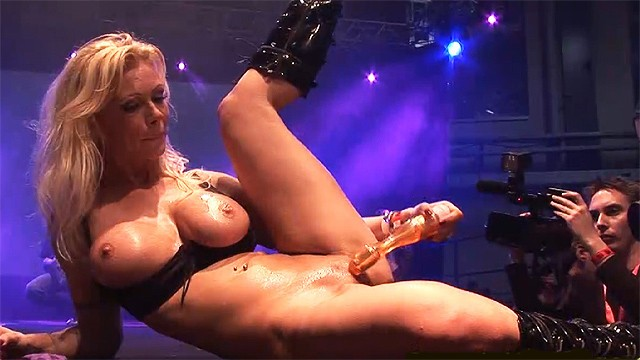 busty german milf toying on public stage