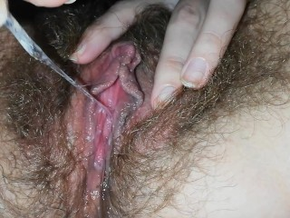 Dirty hairy pussy with big clit masturbates and cums dripping wet close up