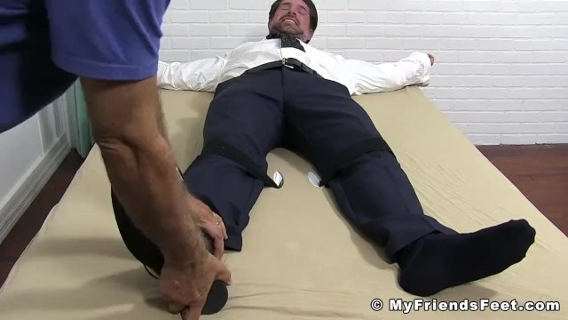 Gay men in suits and ties - Tied up businessman in a suit tickled all over his feet