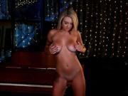 Busty natural pornstar Gabbie Carter masturbates by piano