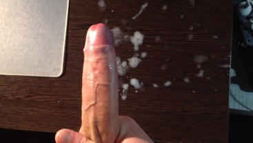 Masturbates and cums on the table. Puddle of semen.