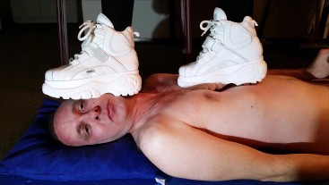 Slave under Buffalo Boots