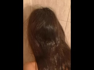 Washing her long beautiful hair with my pee