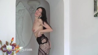 Nimfa Mannay strips off her black stocking to play
