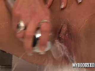 Busty MILF with pierced clit hard masturbate and play with a cream