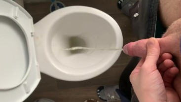 Just simple pissing in a dirty hostels toilet and flushing my piss down