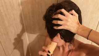 Peeing all over her face while she's sucking a dildo