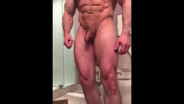 Bodybuilder posing naked