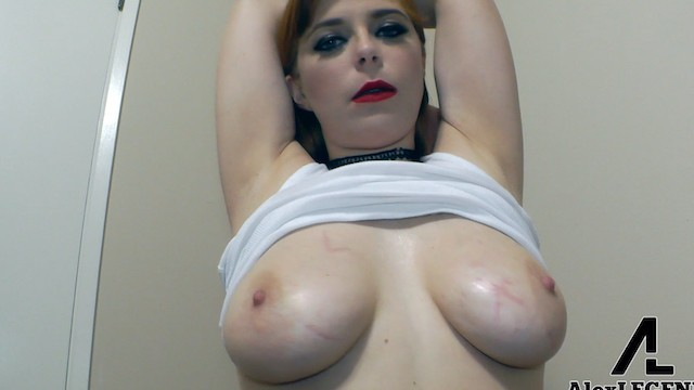 Oily tit wank Sexy redhead plays with her huge oily natural tits