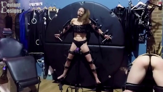 Womens lingerie designed for men K cant escape the vibrator while gagged and strapped to the wheel