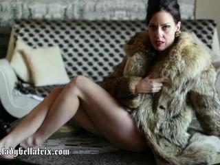 Hu Lke the Wolf Lady Bellatrx rolls around n vntage wolf fur coat