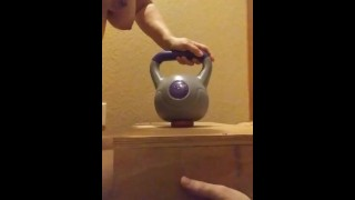 Wife crushes balls with kettle bells
