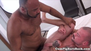 Tattooed stud deepthroating hard black cock
