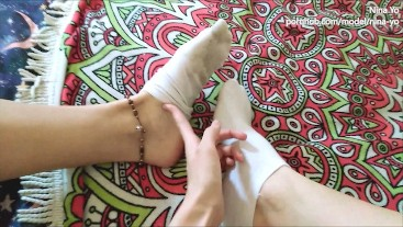 Sexy Girl in White Socks Removes Them Showing Her Bare Feet - Nina Yo