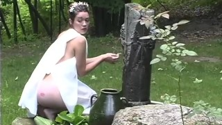Sexy Toga Wearing Brunette Enjoys Outdoor Foreplay