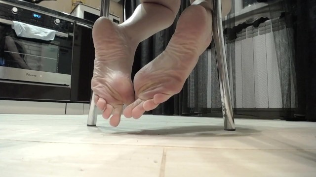 Asian contemporary coffee table - Feet teasing pov under table