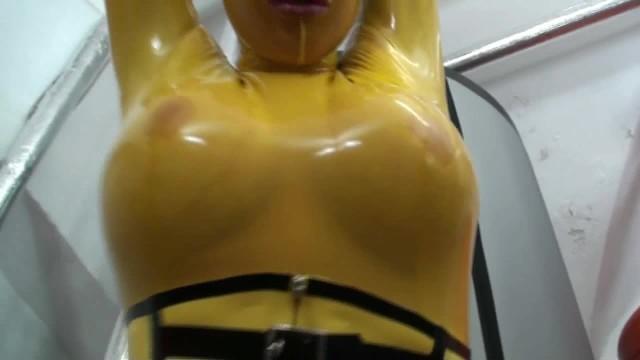 Encased in latex fetish - Girl full encased in yellow latex catsuit fishnets makes self bondage