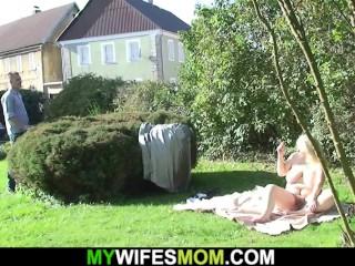 Her boyfriend doggy-fucks busty blonde mother-in-law