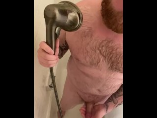 Bearded stud takes shower