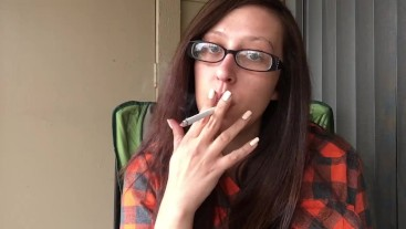 Hot Brunette in Plaid Shirt and Glasses Smoking White Filter 100 Cigarette