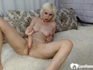 Lusty blonde shoves a toy into her slit