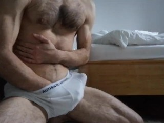 Hunk masturbates in his underwear
