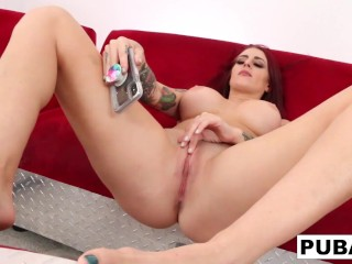 Red headed Tana Lea fucks herself hard on a big red couch