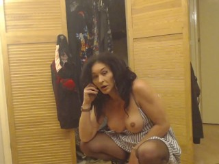 Tranny talking on the phone with her cock in his hand and her boobs out