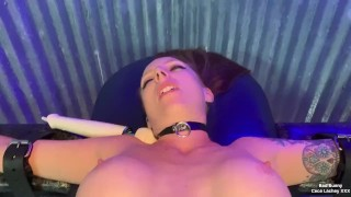 Hot redhead being strapped down to a table for her first Hitachi experience