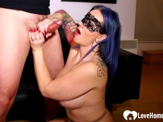 Blue-haired mistress gives a blowjob to her stud