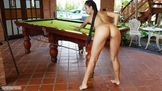 Naked beauty plays billiards