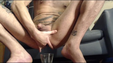 Squirting a ton of piss from my ass into glass w help from Black dildo