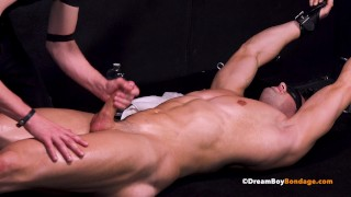 Young Muscle Stud in Bondage Stretched & Jerked Off Until He Cums BDSM