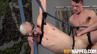 Restrained young sub takes it in his ass after blowjob