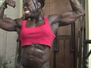 RIpped black female bodybuilder poses and flexes