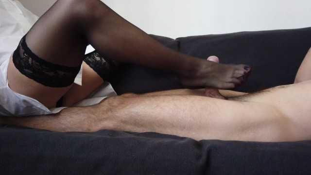 Sexy young stockings fetish movies - A sensual footjob by sexy feet in black stockings