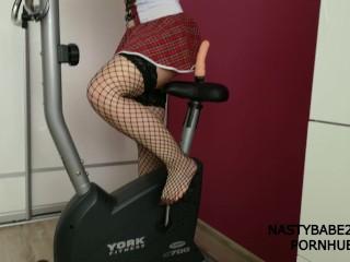Schoolgirl Dildo Riding Workout on Exercise Bike