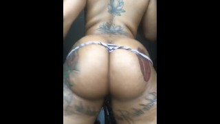 Thick ebony with tattoos shaking her ass