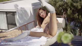 ULTRAFILMS Michaela Isizzu in a beautiful slow striptease and pussy spread