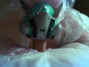 woman in a gas mask and gloves jerks off a cock and sucks. Handjob, blowjob