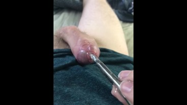 Twink shoots metal sounding rod out of dick  Huge cum shot