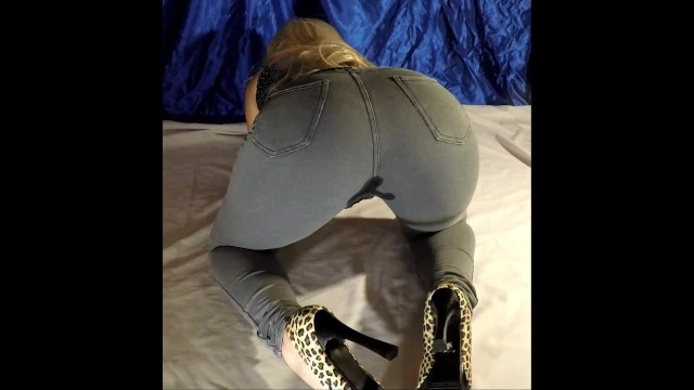 Sexy bad girl looks - Wetting her pants girl pee her jeans in doggstyle pose - wet look leggings