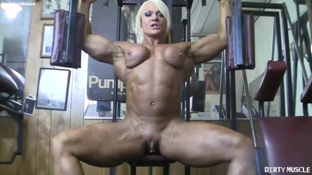 Female naked muscles Naked female bodybuilder poses her big clit in the gym