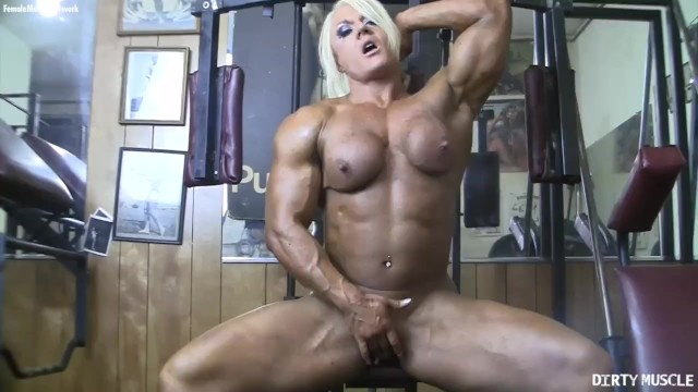 Naked woman bodybuilder - Naked female bodybuilder poses her big clit in the gym