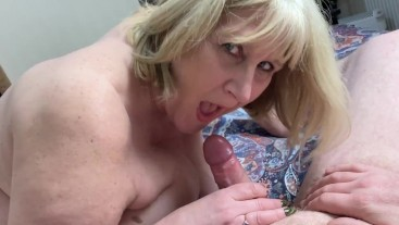 Mature Step Mom gives blow job and gets a mouthful of cum as a reward.
