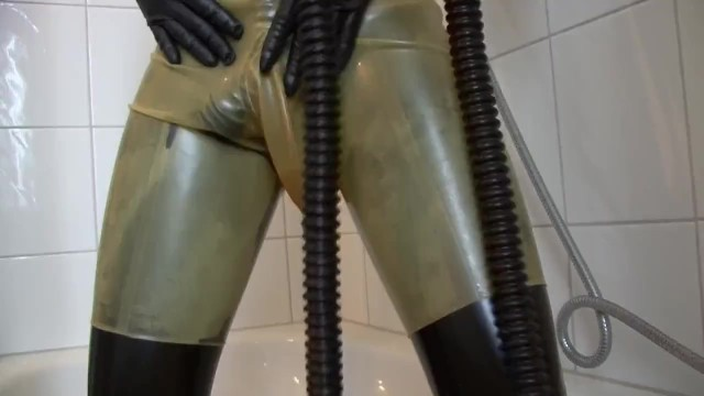 Latex rubber pants Young latex fetish girl fully rubberized with pisspants and gasmask