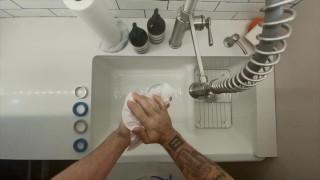 InHome Massage Therapist Austin Wolf Washes Hands