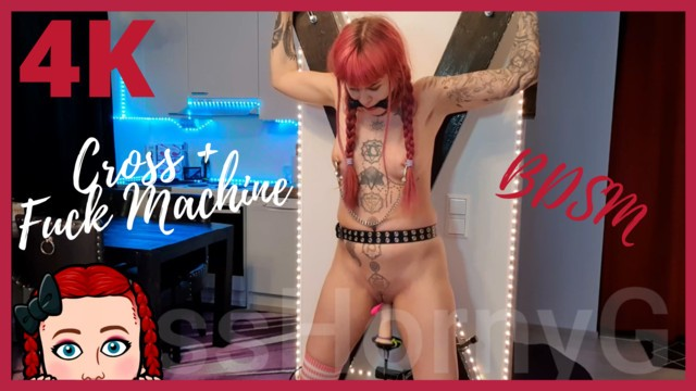 Machine girl sex Fucking machine fuck submissive girl hard on the cross with gag and clamps.